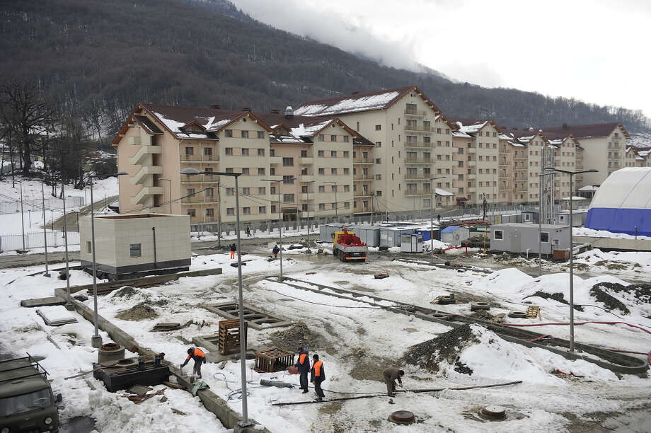 "A picture taken on January 24, 2013, shows a view of the new hotel constructed  near railway station ""Esto-Sadok"", between Adler and Krasnaya Polyana Olympic venues in the Russian Black Sea resort of Sochi. One year before Russia kicks off the 22nd Winter Olympic Games on February 7, 2014, its host city Sochi is one of the world's biggest construction sites, with works proceeding on schedule but declared a disaster by environmentalists. Photo: AFP, AFP/Getty Images / 2013 AFP"