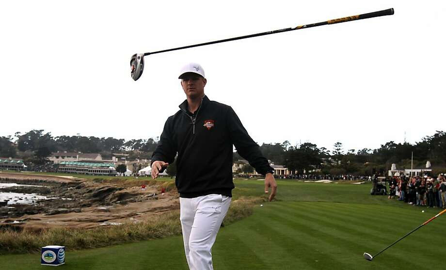 San Francisco Giants pitcher Matt Cain tosses his driver in celebration after hitting a long drive on the 18th hole during the Chevron Charity Shootout between the Giants and the San Francisco 49ers at the AT&T Pebble Beach National Pro-Am Golf Tournament on Tuesday, February 5th, 2013 in Pebble Beach, Calif. Photo: Lance Iversen, The Chronicle