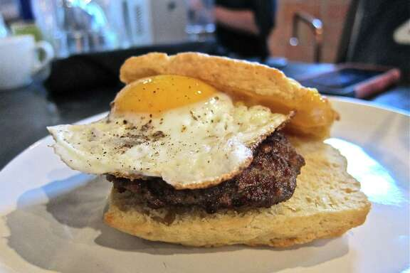 Biscuit sandwich with butcher's sausage, egg and cheddar