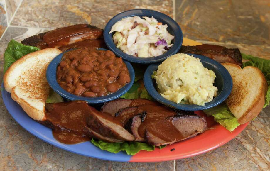 Ray's Real Pit BBQ Shack: This family-owned spot smokes a great sausage, as well as boudin. Try it with the sweet-and-salty fried corn on the cob. Pitmaster Ray Busch has been serving southwest Houston for nearly 30 years. 4529 Old Spanish Trail, 713-748-4227, raysbbqshack.com. Photo: J. Patric Schneider, For The Chronicle / 2012 Houston Chronicle
