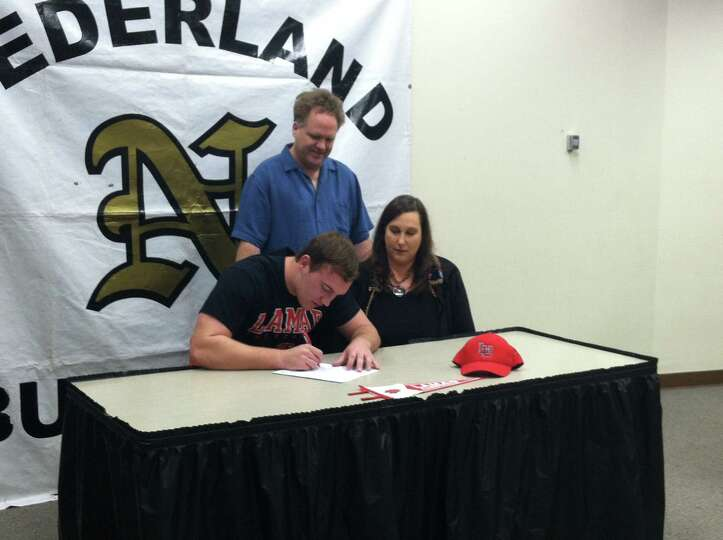 Nederland football player Koby Couron signed with Lamar University on Wednesday, Feb. 6, 2012.