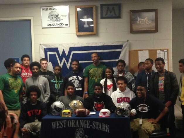 West Orange-Stark seniors pose following National Signing Day festivities in the team's locker room. Photo: Avi Zaleon