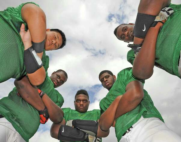 The Port Arthur Memorial offensive line, consisting of Toan Nguyen, left, Vernon Samuels, Dekovin Antoine, Selah Fontenot, and Brendan Vaughn, right, has helped Memorial stay undefeated (6-0) so far this season. This offensive line, which only returned one started this season, Nguyen, will play undefeated North Shore on Friday night October 12, 2012.   Dave Ryan/The Enterprise Photo: Dave Ryan