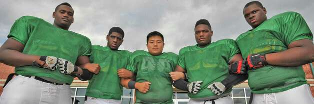 The Port Arthur Memorial offensive line, consisting of Brendan Vaughn, Selah Fontenot, left, Toan Nguyen, Dekovin Antoine, and Vernon Samuels, right,  helped Memorial  with their record this past season. This offensive line,  only returned one starter this season, Nguyen. Dave Ryan/The Enterprise Photo: Dave Ryan