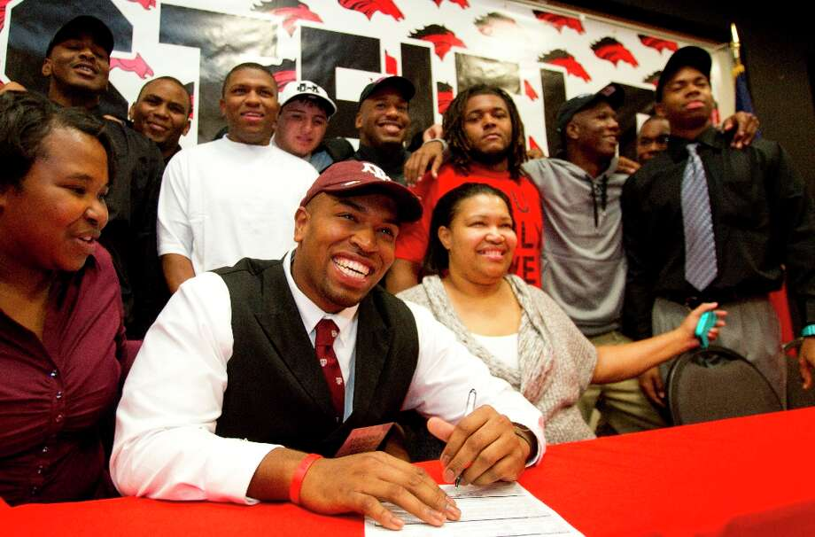 Texas A&M signee Hardreck Walker is all smiles. Photo: Brett Coomer / © 2013 Houston Chronicle