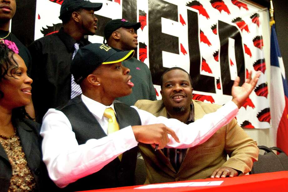 Texas Lutheran signee Cameron Scott calls his friends and teammates over to pose for a photo during a National Letter of Intent signing ceremony on Wednesday. Photo: Brett Coomer / © 2013 Houston Chronicle