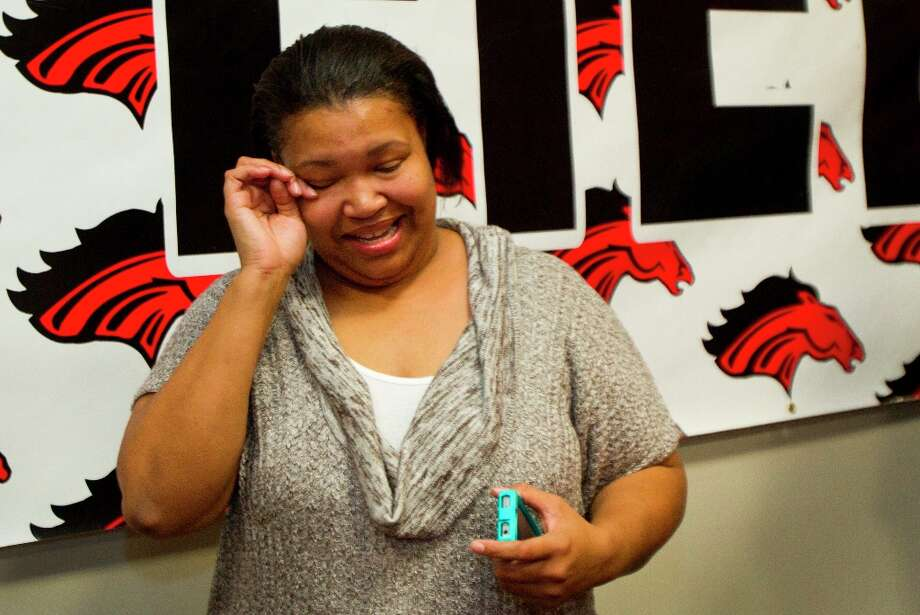 Morgan Hall, mother of Texas A&M signee Hardreck Walker, wipes away a tear during the signing ceremony. Photo: Brett Coomer / © 2013 Houston Chronicle