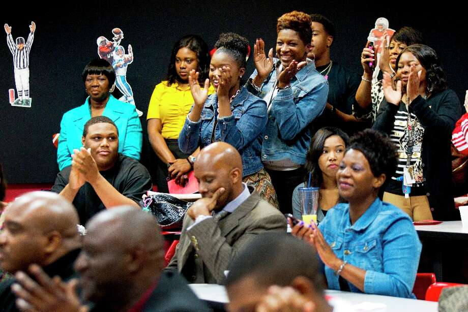 Friends and family of college-bound Westfield High School football players applaud as they are introduced during a National Letter of Intent signing ceremony. Photo: Brett Coomer / © 2013 Houston Chronicle