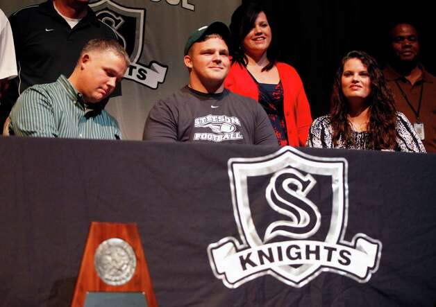 Steele High School  football player Cory Staud ,wearing hat, smiles Wednesday Feb. 6, 2013 after signing a letter of intent on National Signing Day to play football at Stetson University. Photo: William Luther, San Antonio Express-News / © 2013 San Antonio Express-News