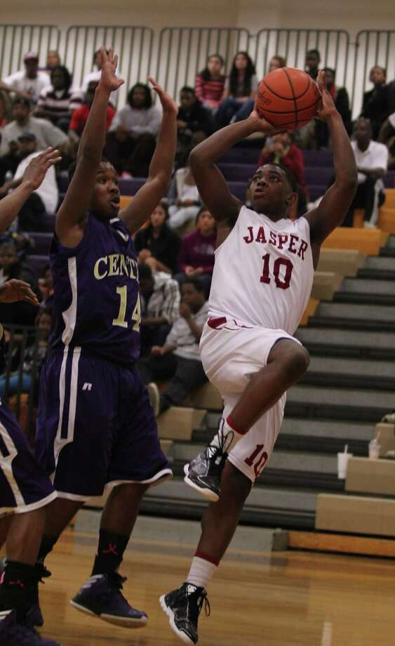 Jarrell Armstrong goes up for a jumper against Center. Photo: Jason Dunn