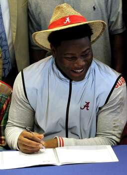 Reuben Foster signs a letter of intent to attend the University of Alabama and play college football during National Signing Day on Wednesday, Feb. 6, 2013, in Auburn, Ala. (AP Photo/Butch Dill) Photo: Butch Dill, Associated Press / FR111446 AP