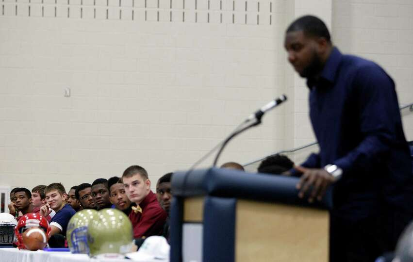 Fort Bend ISD students who committed to play football in college listen to  former George Bush High