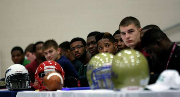Fort Bend ISD students who committed to play football in college listen to  former George Bush High School student and current Seattle Seahawk NFL player Russell Okung speak, who also played at Oklahoma State University, during a signing day ceremony at the Buddy Hopson Field House Tuesday, Feb. 5, 2013, in Missouri City. Photo: Johnny Hanson, Houston Chronicle / © 2013  Houston Chronicle