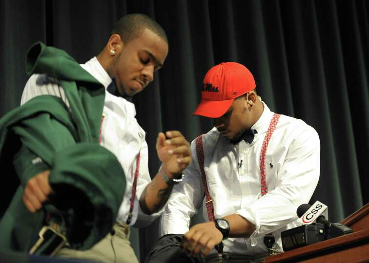 Grayson High School football player Robert Nkemdiche, right, the nation's top recruit, and his broth