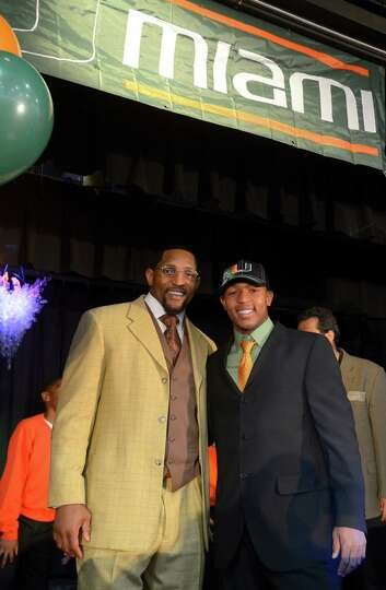 Ray Lewis III, right, poses for photos with his father, former Baltimore Ravens linebacker Ray Lewis