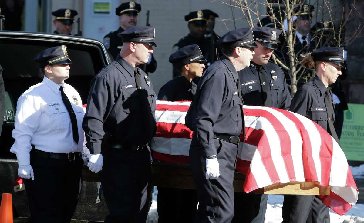 Pallbearers carry the casket of former Buffalo Police Officer Patricia Parete during funeral services in Buffalo, N.Y., Wednesday, Feb. 6, 2013. Parete, was shot and paralyzed while on duty six years ago. She died last Saturday at her Niagara County home. Parete and another Buffalo police officer were shot in December 2006 after responding to a fight at a convenience store. One of the bullets hit Parete in the chin and lodged in her spine. The other officer also survived. The man who shot them, Varner Harris Jr., is serving 30 years to life in a state prison.