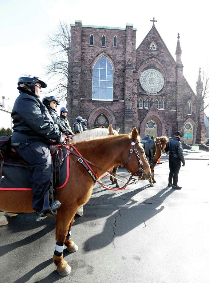 Buffalo Police officers arrive for the funeral of former Buffalo Police Officer Patricia Parete in Buffalo, N.Y., Wednesday, Feb. 6, 2013.  Parete, was shot and paralyzed while on duty six years ago. She died last Saturday at her Niagara County home.  Parete and another Buffalo police officer were shot in December 2006 after responding to a fight at a convenience store. One of the bullets hit Parete in the chin and lodged in her spine. The other officer also survived. The man who shot them, Varner Harris Jr., is serving 30 years to life in a state prison. Photo: David Duprey, AP / AP
