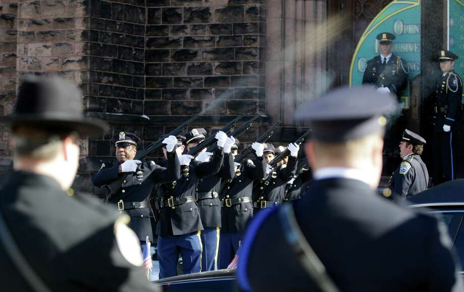 A 21-gun salute is performed to honor former Buffalo Police Officer Patricia Parete during her funeral in Buffalo, N.Y., Wednesday, Feb. 6, 2013. Parete, was shot and paralyzed while on duty six years ago. She died last Saturday at her Niagara County home.  Parete and another Buffalo police officer were shot in December 2006 after responding to a fight at a convenience store. One of the bullets hit Parete in the chin and lodged in her spine. The other officer also survived. The man who shot them, Varner Harris Jr., is serving 30 years to life in a state prison. Photo: David Duprey, AP / AP