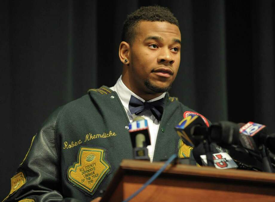 Grayson High School football player Robert Nkemdiche, the nation's top recruit, announces his intent to play college football for Ole Miss, at a Grayson, Ga., signing ceremony Wednesday Feb. 6, 2013. (AP Photo/David Tulis) Photo: Dave Tulis, Associated Press / FR170493 AP