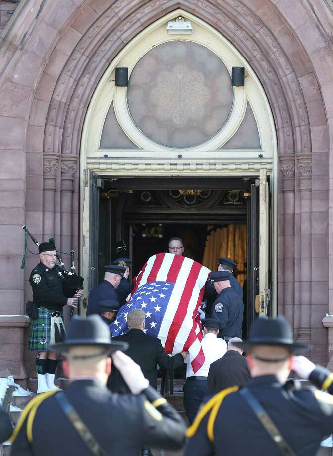 Pallbearers carry the casket of former Buffalo Police Officer Patricia Parete during funeral services in Buffalo, N.Y., Wednesday, Feb. 6, 2013. Parete,  was shot and paralyzed while on duty six years ago. She died last Saturday at her Niagara County home.  Parete and another Buffalo police officer were shot in December 2006 after responding to a fight at a convenience store. One of the bullets hit Parete in the chin and lodged in her spine. The other officer also survived. The man who shot them, Varner Harris Jr., is serving 30 years to life in a state prison. Photo: Mark Mulville, AP / The Buffalo News
