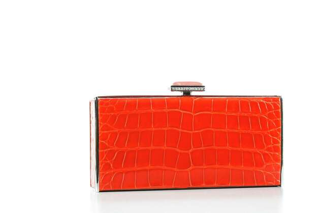 Judith Leiber handbag: tangerine clutch, $3,495, at Neiman Marcus, photographed in the Houston Chronicle Photo Studio, Tuesday, Jan. 22, 2013, in Houston. Photo: Michael Paulsen, Houston Chronicle / © 2013 Houston Chronicle