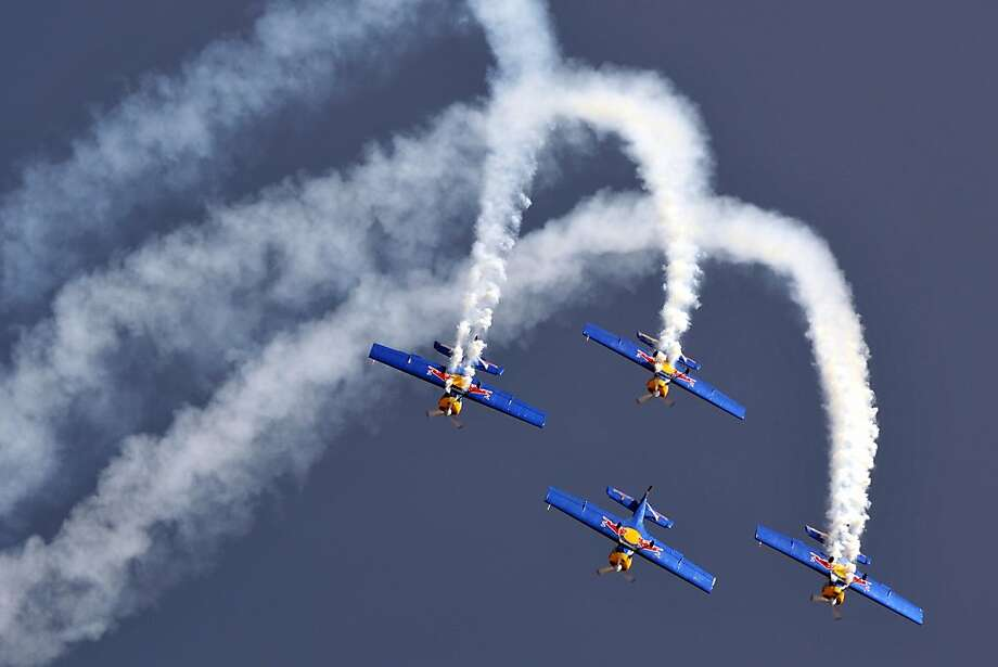 A Bull without a tail:As the Czech Republic's Flying Bulls aerobatics team performs a loop at Aero India 2013  in Bangalore, the lead plane loses its vapor trail. Photo: Manjunath Kiran, AFP/Getty Images