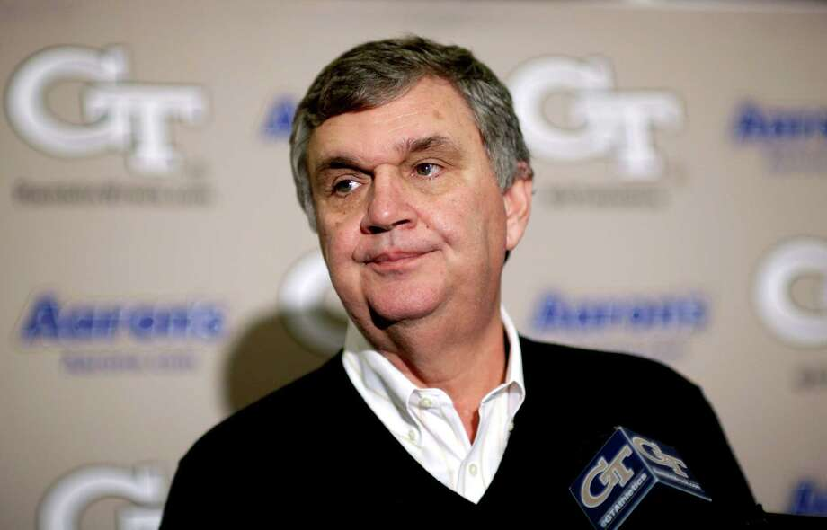 Georgia Tech head football coach Paul Johnson talks about the team's new recruits during a national signing day news conference, Wednesday, Feb. 6, 2013, in Atlanta. Georgia Tech didn't have room to sign a big class, so Johnson says he focused on filling needs with his class of 14 signees. The class is highlighted by running back Travis Custis of Lovejoy High School and offensive linemen Shamire DeVine of Atlanta's Tri-Cities High School and Chris Griffin of Panacea, Fla. The class is not highly rated, but Johnson says many of his all-Atlantic Coast Conference players were not highly rated by recruiting experts. (AP Photo/David Goldman) Photo: David Goldman, Associated Press / AP