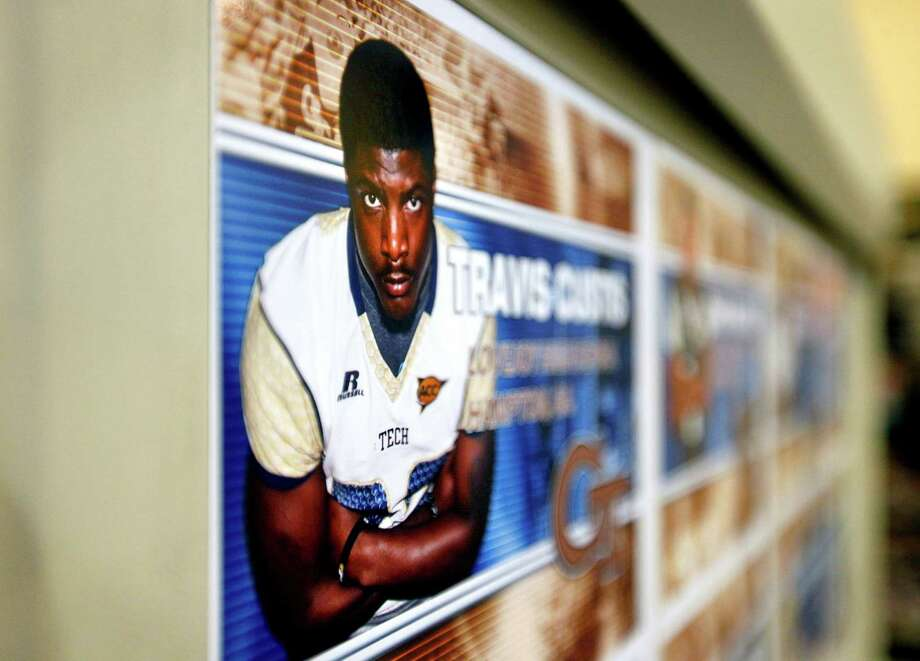 An image of new recruit Travis Custis is displayed on a board after Georgia Tech head football coach Paul Johnson spoke at a signing day news conference, Wednesday, Feb. 6, 2013, in Atlanta. Georgia Tech didn't have room to sign a big class, so Johnson says he focused on filling needs with his class of 14 signees. The class is highlighted by running back Travis Custis of Lovejoy High School and offensive linemen Shamire DeVine of Atlanta's Tri-Cities High School and Chris Griffin of Panacea, Fla. The class is not highly rated, but Johnson says many of his all-Atlantic Coast Conference players were not highly rated by recruiting experts. (AP Photo/David Goldman) Photo: David Goldman, Associated Press / AP