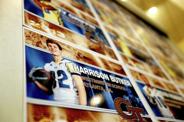 An image of new recruit Harrison Butker is displayed on a board after Georgia Tech head football coach Paul Johnson spoke at a signing day news conference, Wednesday, Feb. 6, 2013, in Atlanta. Georgia Tech didn't have room to sign a big class, so Johnson says he focused on filling needs with his class of 14 signees. The class is highlighted by running back Travis Custis of Lovejoy High School and offensive linemen Shamire DeVine of Atlanta's Tri-Cities High School and Chris Griffin of Panacea, Fla. The class is not highly rated, but Johnson says many of his all-Atlantic Coast Conference players were not highly rated by recruiting experts. (AP Photo/David Goldman) Photo: David Goldman, Associated Press / AP