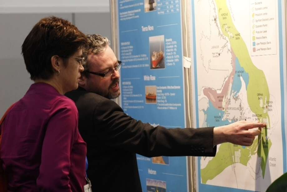 Lisa Marlow, of Shell, left, and David Middleton look at a Newfoundland and Labrador Basins map during the NAPE Expo at the George R. Brown Convention Center Tuesday, Feb. 5, 2013, in Houston.