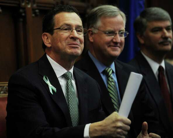 Gov. Dannel P. Malloy, left, following his biennial budget address before a joint session of the legislature at the Capitol in Hartford on Wednesday, February 6, 2013. Photo: Brian A. Pounds / Connecticut Post