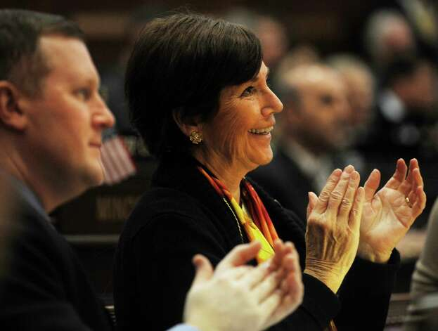 Greenwich representatives Stephen Walko, left, and Livvy Floren applaud during Gov. Dannel P. Malloy's budget address before a joint session of the legislature at the Capitol in Hartford on Wednesday, February 6, 2013. Photo: Brian A. Pounds / Connecticut Post