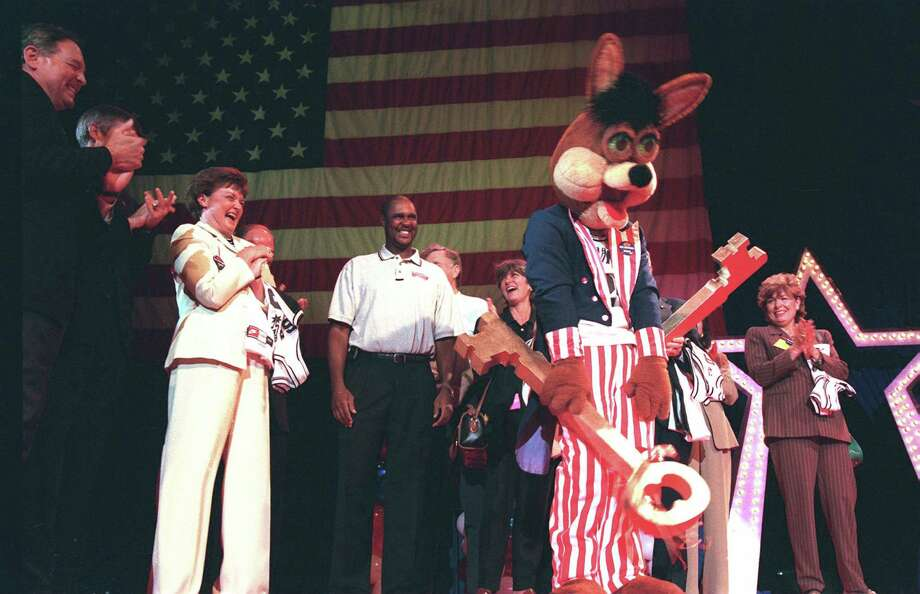 The Coyote looks back to the crowd as he prepares to present the key to members of the RNC convention committee at the Alamodome in 1998. Photo: Delcia Loepz, SAN ANTONIO EXPRESS-NEWS / SAN ANTONIO EXPRESS-NEWS