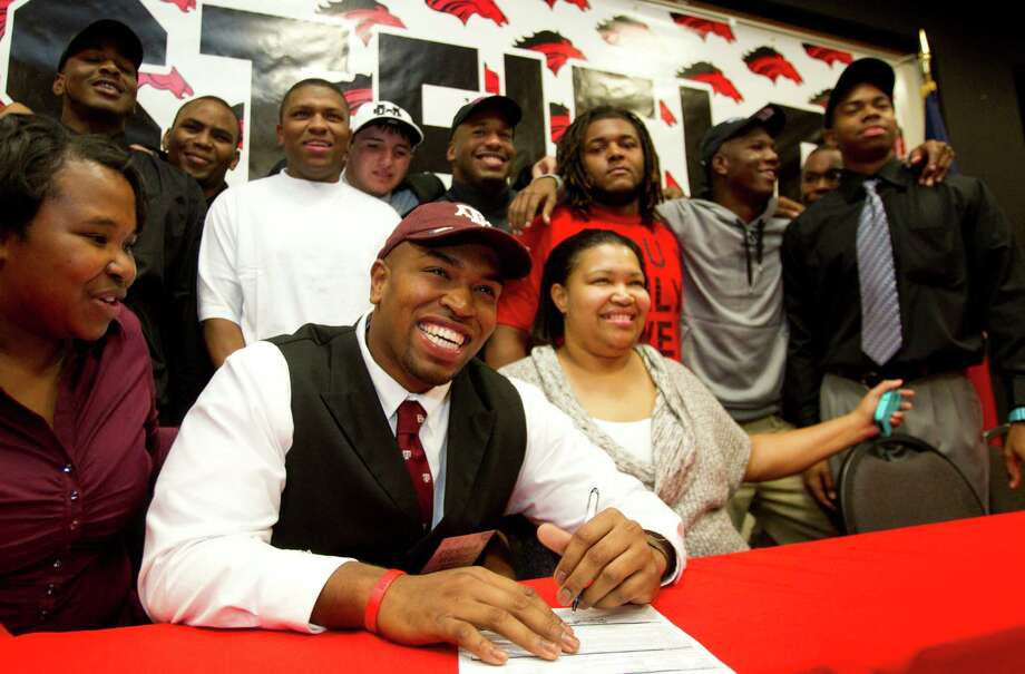 Texas A&M signee Hardreck Walker is all smiles during a National Letter of Intent signing ceremony at Westfield High School Wednesday, Feb. 6, 2013, in Houston. Photo: Brett Coomer, Houston Chronicle / © 2013 Houston Chronicle