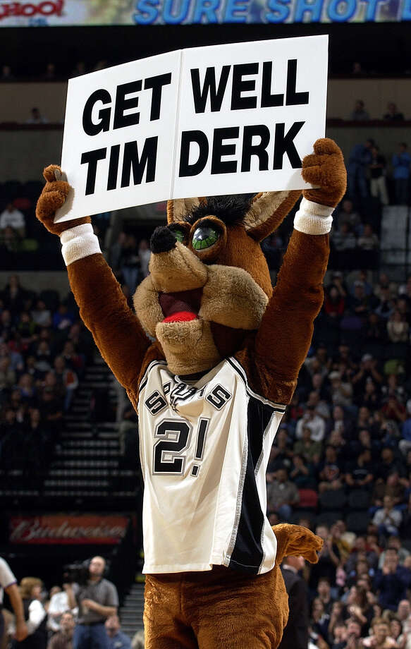 The Coyote shows his support for the Spurs' original mascot, Tim Derk, who was recovering from a stroke, during a timeout Feb. 24, 2004. Photo: WILLIAM LUTHER, SAN ANTONIO EXPRESS-NEWS / SAN ANTONIO EXPRESS-NEWS