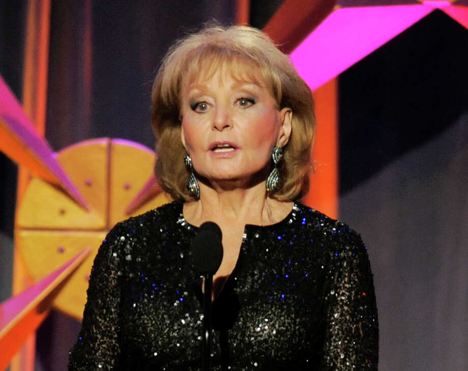 """FILE - This June 23, 2012 file photo shows Barbara Walters presenting an award onstage at the 39th Annual Daytime Emmy Awards in Beverly Hills, Calif. Walters, who has been battling the Chicken Pox, will not return to her daytime talk show """"The View,"""" for three more weeks. She was hospitalized on Jan. 19 after fainting and cutting her head at a pre-inaugural party in Washington.  (Photo by Chris Pizzello/Invision/AP, file) Photo: Chris Pizzello"""