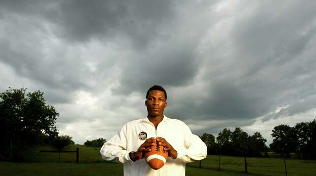 Ricky Seals-Jones, Sealy High School football star and one of the top ranked players in the country, stand on his families land as a storm passes Thursday, Oct. 11, 2012, in Sealy. Ricky's father Chester Jones says Ricky gets 15-20 recruiting letters daily. Photo: Nick De La Torre, Houston Chronicle / 2012  Houston Chronicle