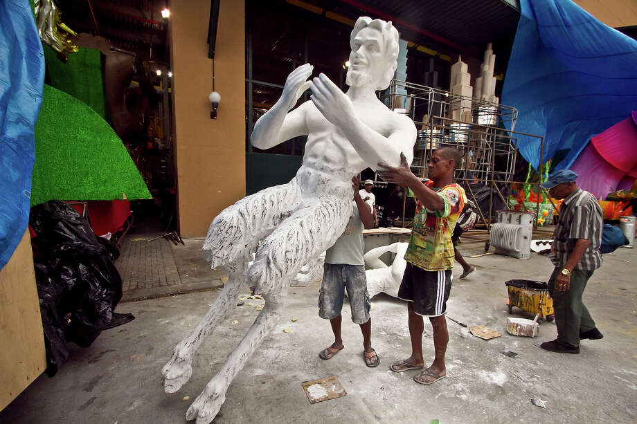 A man works during the preparations for Brazilian Carnival 2013 on February 05, 2013 in Rio de Janeiro, Brazil. Photo: Alexandro Auler/CON, LatinContent/Getty Images / 2013 Alexandro Auler