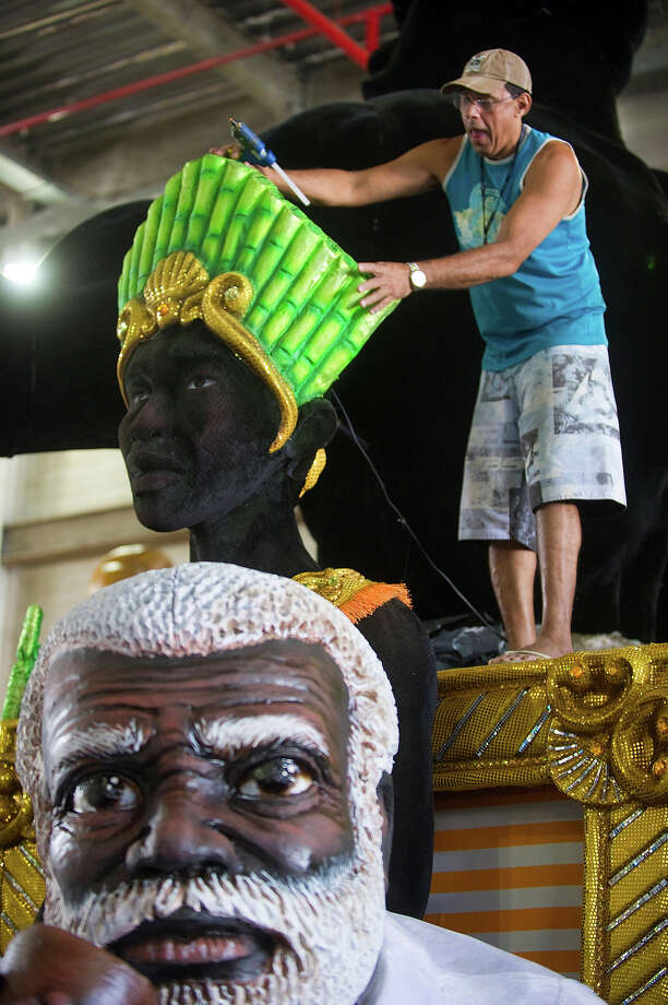 A Portela samba school member works on a float on February 6, 2013, during preparations ahead of the traditional Rio de Janeiro samba school parade next February 10 and 11. Photo: ANTONIO SCORZA, AFP/Getty Images / 2013 AFP