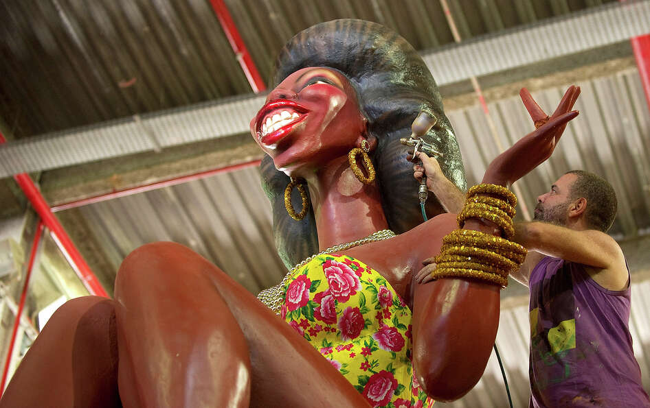 A Portela samba school member works on a float on February 6, 2013, during preparations ahead of the