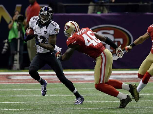 Baltimore Ravens wide receiver Jacoby Jones (12) returns a kickoff as San Francisco 49ers tight end Delanie Walker (46) approaches during the first half of NFL Super Bowl XLVII football game Sunday, Feb. 3, 2013, in New Orleans. (AP Photo/Elise Amendola) Photo: Elise Amendola, Associated Press / AP
