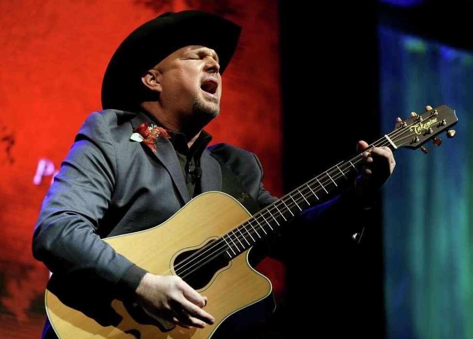 FILE - This Oct. 7, 2012 photo shows Garth Brooks singing