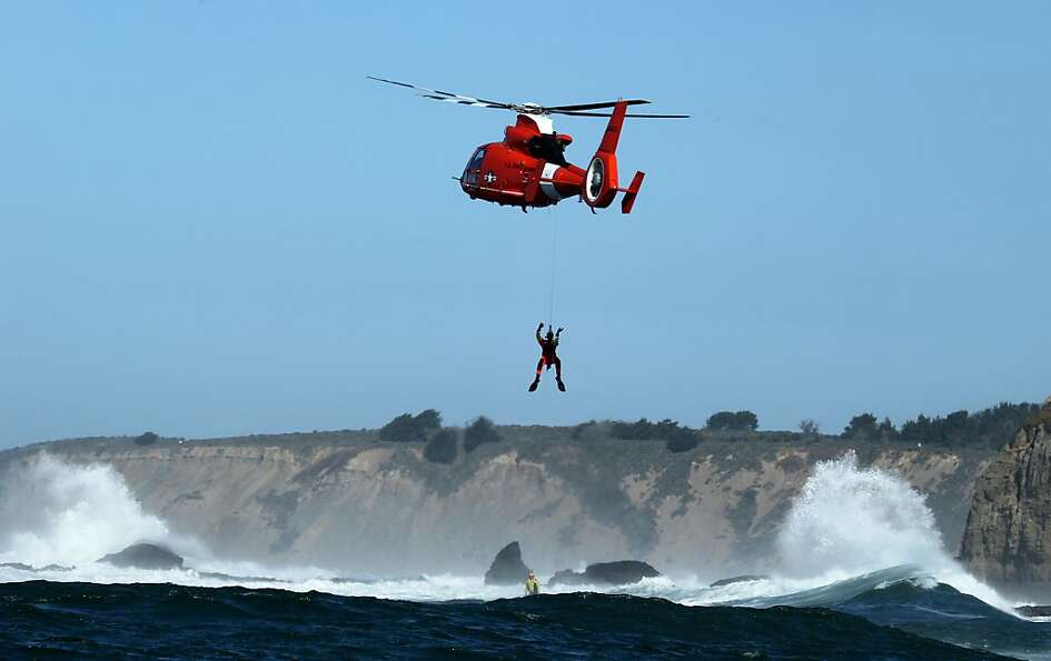 Members of the United States Coast Guard practice rescue maneuvers off the Mavericks,  Wednesday Feb