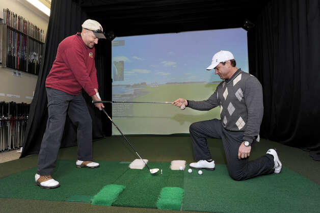 Steve Jordan, left, of Roxbury, has his clubs fitted by Chris Velander, of New Milford, at Performance Clubworks in Brookfield, Wednesday, February, 6, 2013. Photo: Carol Kaliff