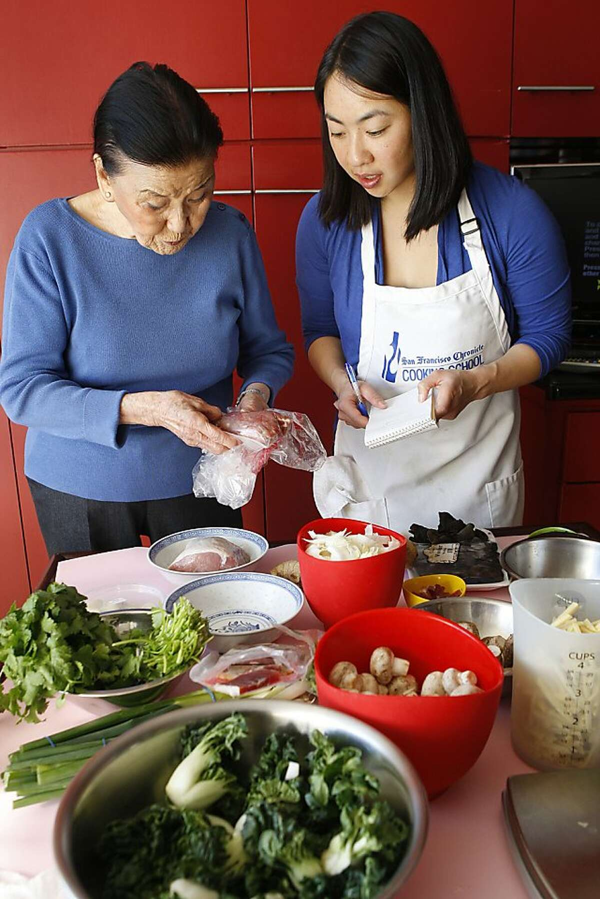 Cecilia Chang showing Janny Hu how to make recipes for Chinese New Year at her home in San Francisco, Calif., on Friday, January 25, 2013.