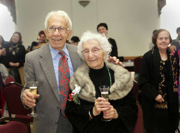 "John and Ann Betar, of Fairfield, celebrate their 80th anniversary at St. Nicholas Antiochian Orthodox Church, in Bridgeport, Conn. on Sunday, November 25, 2012. The Fairfield couple have been named the 2013 ""longest married couple"" in the United States by Worldwide Marriage Encounter, a group in San Bernardino, Calif., dedicated to improving Christian marriages. The Betars will be presented with the honor and gifts at their granddaughter's home in Fairfield, Conn. on Saturday, Feb. 9, 2013. Photo: BK Angeletti, B.K. Angeletti / Connecticut Post freelance B.K. Angeletti"