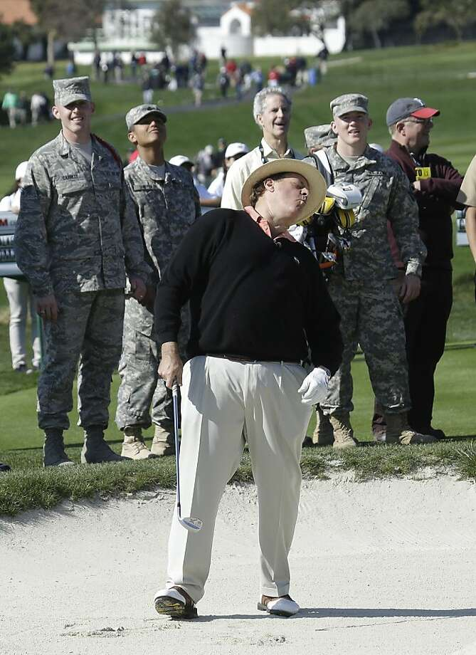 Sportscaster Chris Berman reacts after hitting out of a bunker onto the second green of the Pebble Beach Golf Links during the celebrity challenge event of the AT&T Pebble Beach Pro-Am golf tournament Wednesday, Feb. 6, 2013 in Pebble Beach, Calif. (AP Photo/Ben Margot) Photo: Ben Margot, Associated Press