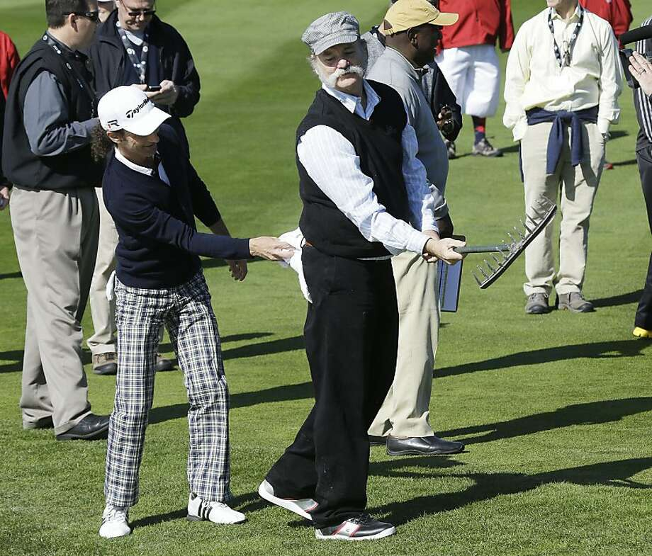 Actor Bill Murray, right, is dusted off my musician Kenny G, left, after Murray made an angel imprint in a bunker on the second hole of the Pebble Beach Golf Links during the celebrity challenge event of the AT&T Pebble Beach Pro-Am golf tournament  Wednesday, Feb. 6, 2013 in Pebble Beach, Calif. (AP Photo/Ben Margot) Photo: Ben Margot, Associated Press