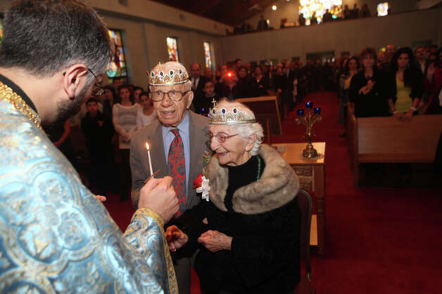 "John and Ann Betar, of Fairfield, celebrate their 80th anniversary at St. Nicholas Antiochian Orthodox Church, in Bridgeport, Conn. on Sunday, November 25, 2012. The couple have been named the 2013 ""longest married couple"" in the United States by Worldwide Marriage Encounter, a group in San Bernardino, Calif., dedicated to improving Christian marriages. The Betars will be presented with the honor and gifts at their granddaughter's home in Fairfield, Conn. on Saturday, Feb. 9, 2013. Photo: BK Angeletti, B.K. Angeletti / Connecticut Post freelance B.K. Angeletti"