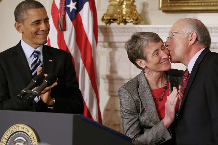 WASHINGTON, DC - FEBRUARY 06:  REI Chief Executive Officer Sally Jewell (C) is congratulated by outgoing Interior Secrtary Ken Salazar after she was nominated by President Barack Obama to be the next Secretary of the Interior in the State Dining Room of the White House February 6, 2013 in Washington, DC. Jewell has been CEO of the huge outdoor retailer REI since 2005. Photo: Chip Somodevilla, Getty Images / 2013 Getty Images